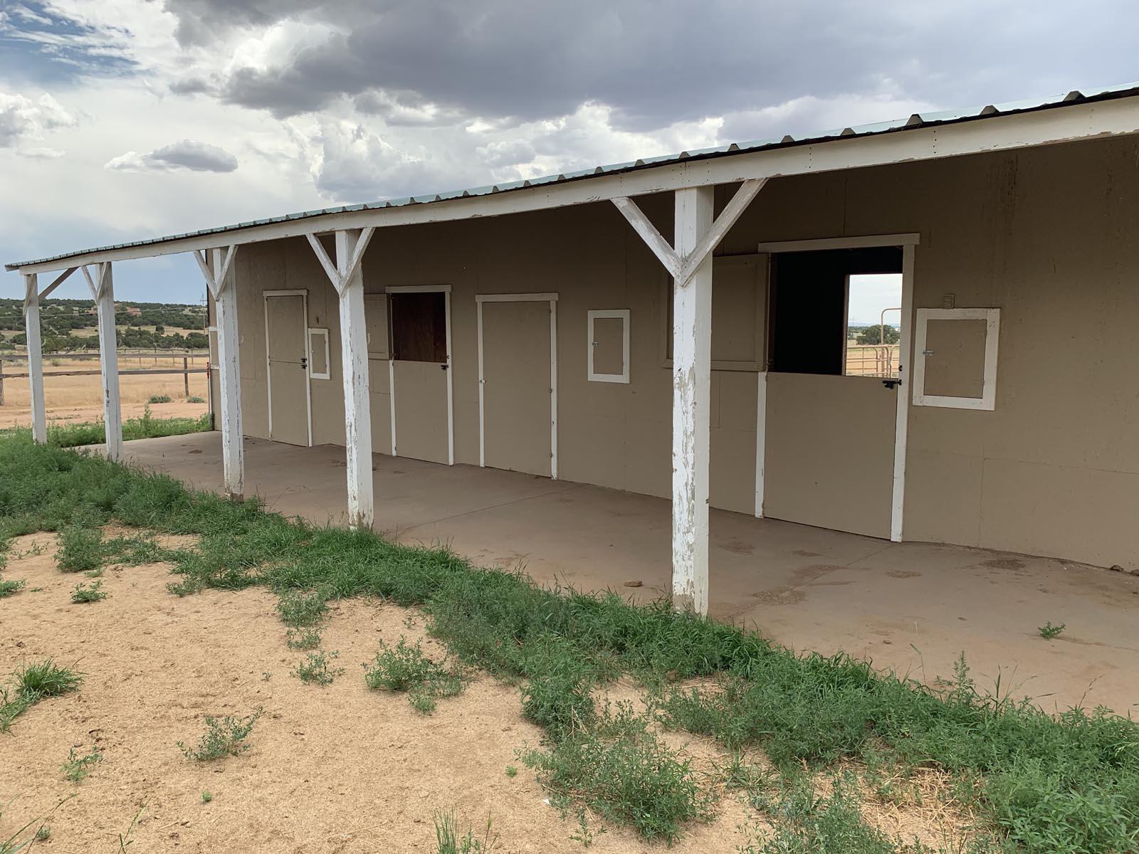 Stalls at Tiger Owl Ranch horse boarding facility in Santa Fe, New Mexico