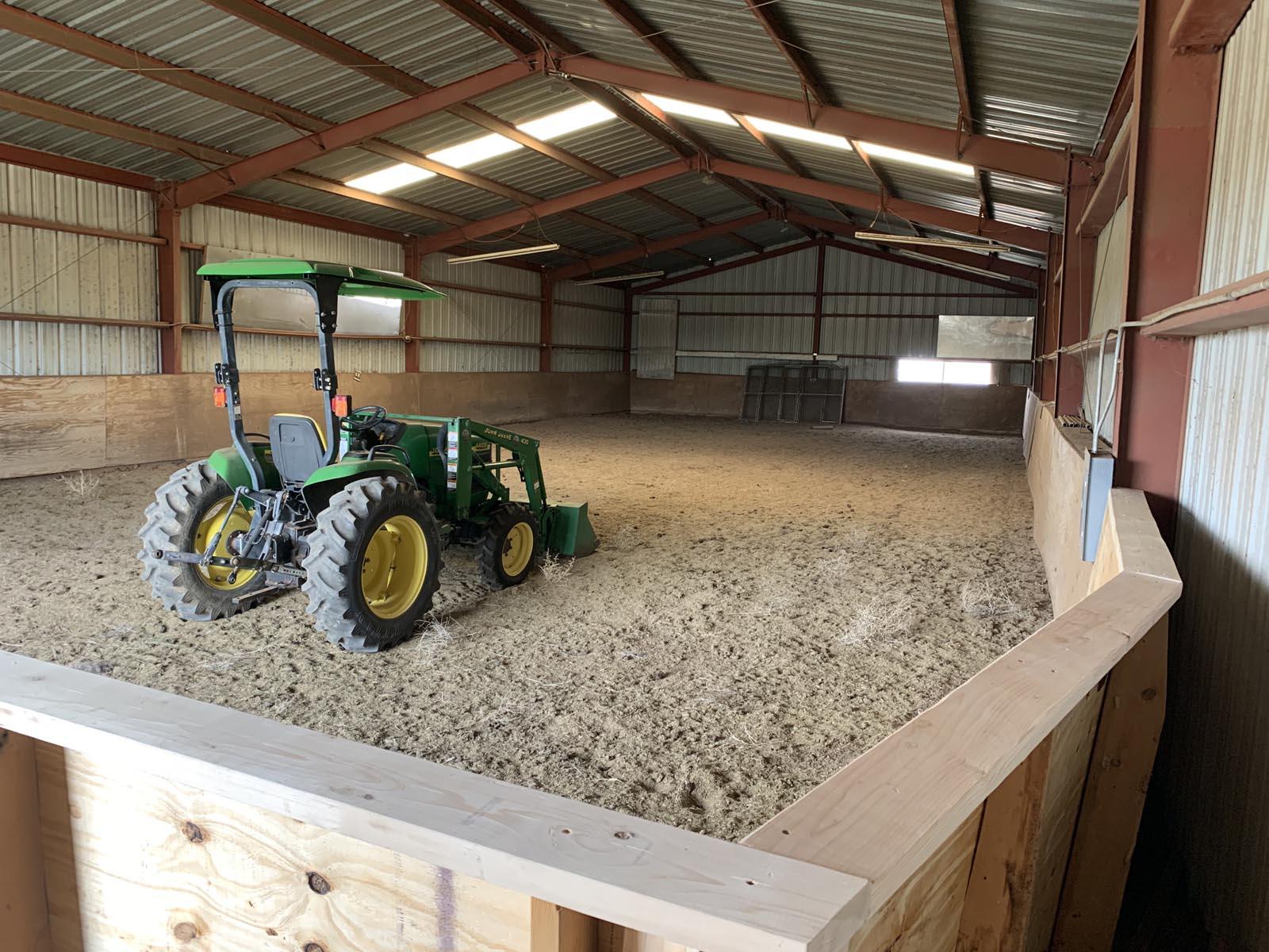 Indoors at Tiger Owl Ranch horse boarding facility in Santa Fe, New Mexico
